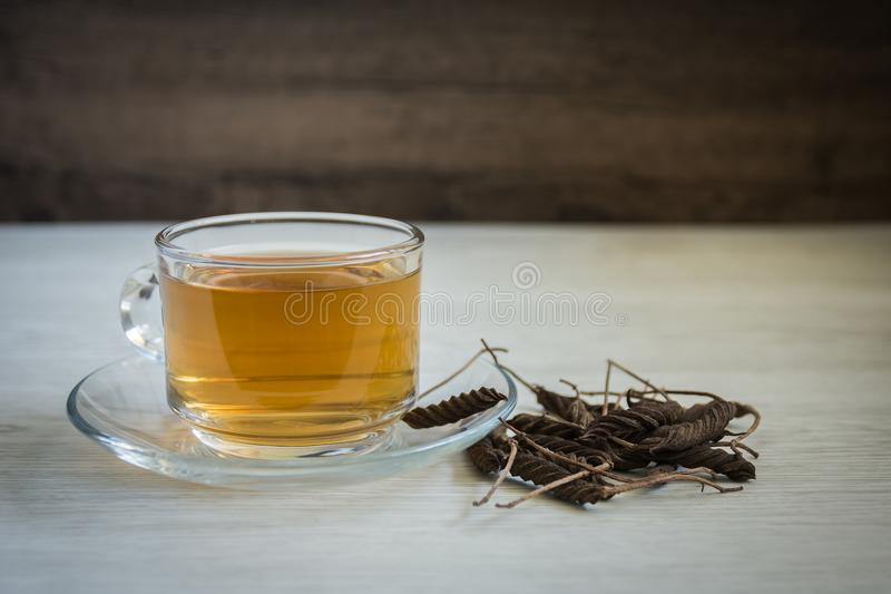 East Indian tree,Helicteres isora L.,Sterculiaceae. Boiled water with herbs on wooden background Help treat gout, joint pain, back pain, knee pain,Reduce fat in stock photos