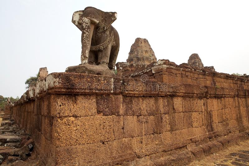 East Mebon temple ruins. Architecture details of the brick platform and elephant sculpture at the East Mebon temple ruins, Angkor, Siem Reap, Cambodia. East stock image