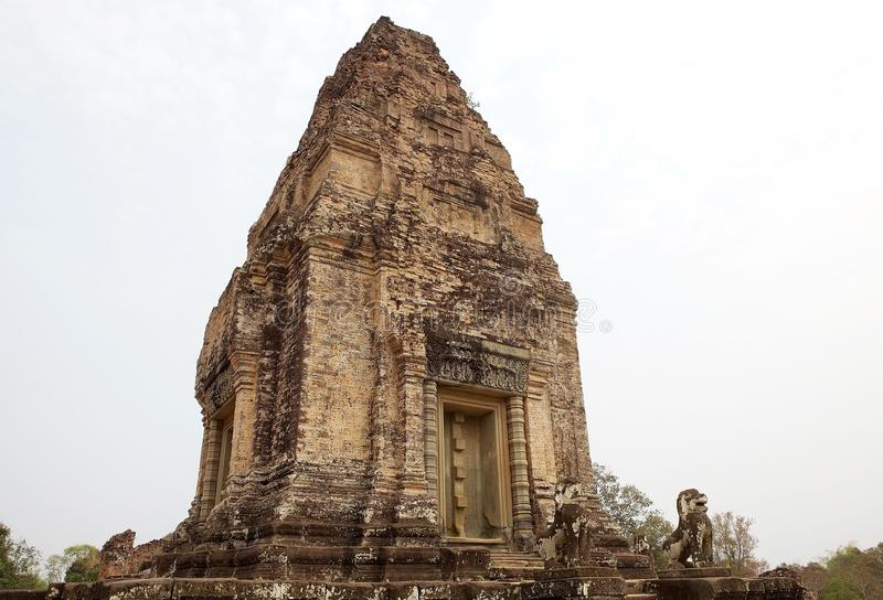East Mebon temple ruins. The upper tower with the lion guardians at the East Mebon temple ruins, Angkor, Siem Reap, Cambodia. East Mebon temple was built in the royalty free stock images