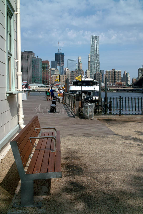 East River Ferry and New York Skyline USA. The changing New York skyline. Looking West over the East River to Manhattan from Brooklyns Fulton Ferry Landing. The stock photos