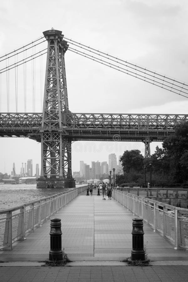 The East River Promenade and Williamsburg Bridge, in Manhattan, New York City royalty free stock photography