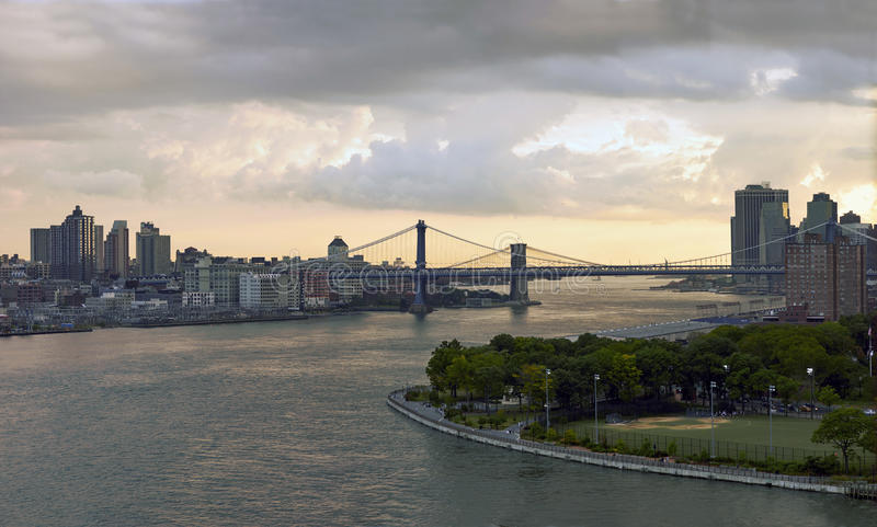 East river sunset from the bridge. Sunset of Manhattan and Brooklin betwen East river from the Wiliamsbourg bridge stock images