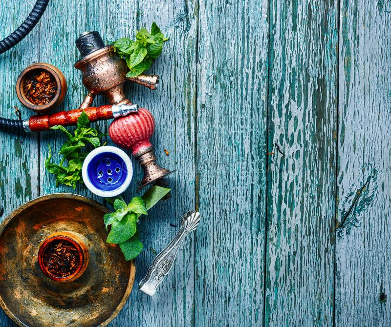 Smoking hookah with mint. East smoking hookah with mint flavor.Shisha mint tobacco.Shisha hookah with spearmint stock images
