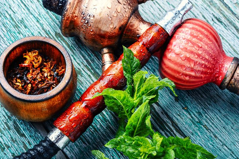 Turkish hookah with mint. East smoking hookah with mint flavor.Shisha mint tobacco royalty free stock image