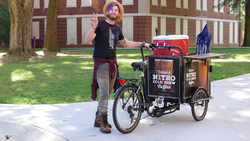 East Tennessee State University - Coffee Vendor. Johnson City - Coffee vendor and his tricycle royalty free stock image
