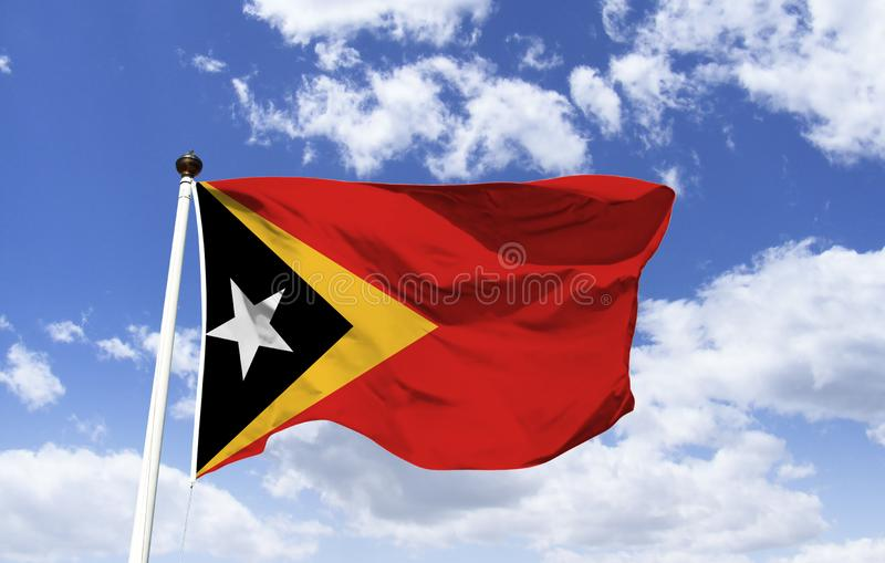 East Timor flag template floating under the blue sky royalty free stock image