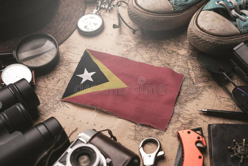 East Timor Flag Between Traveler`s Accessories on Old Vintage Map. Tourist Destination Concept.  stock photo