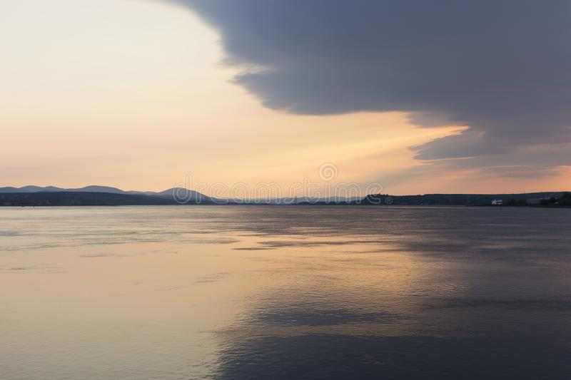 East view of the St. Lawrence River, with the Island of Orleans Bridge and Beauport Coast in the background. At dawn, Quebec City, Quebec, Canada royalty free stock photography