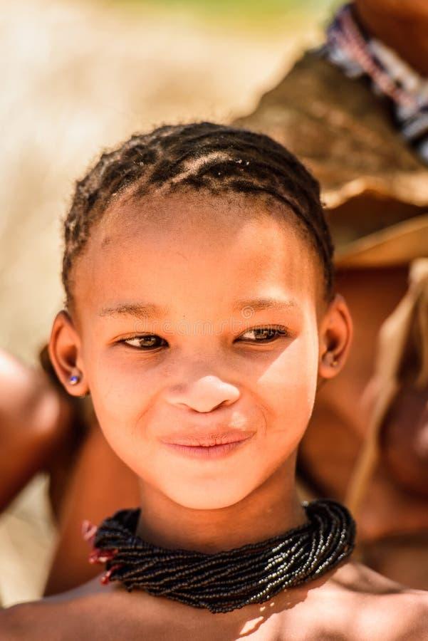 Bushman people in Namibia. EAST OF WINDHOEK, NAMIBIA - JAN 3, 2016: Unidentified bushman beautiful girl. Bushman people are members of various indigenous hunter stock images