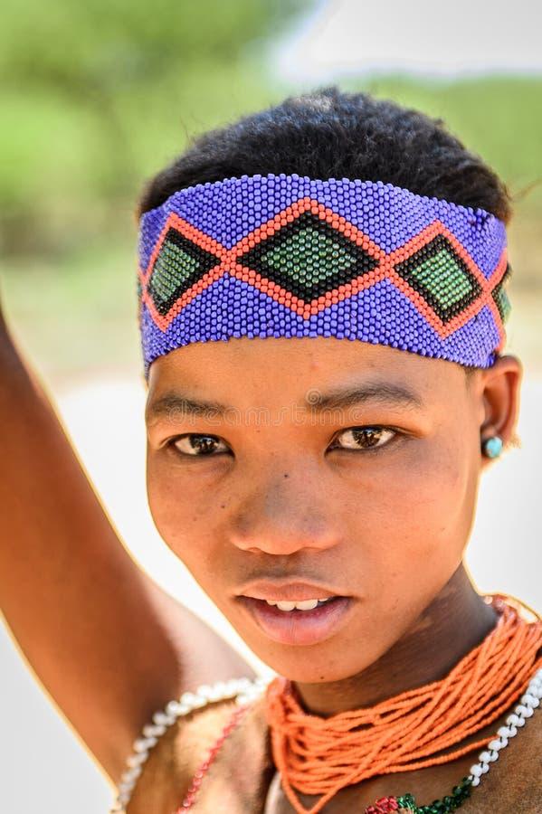 Bushman people in Namibia. EAST OF WINDHOEK, NAMIBIA - JAN 3, 2016: Unidentified bushman beautiful girl. Bushman people are members of various indigenous hunter royalty free stock photo