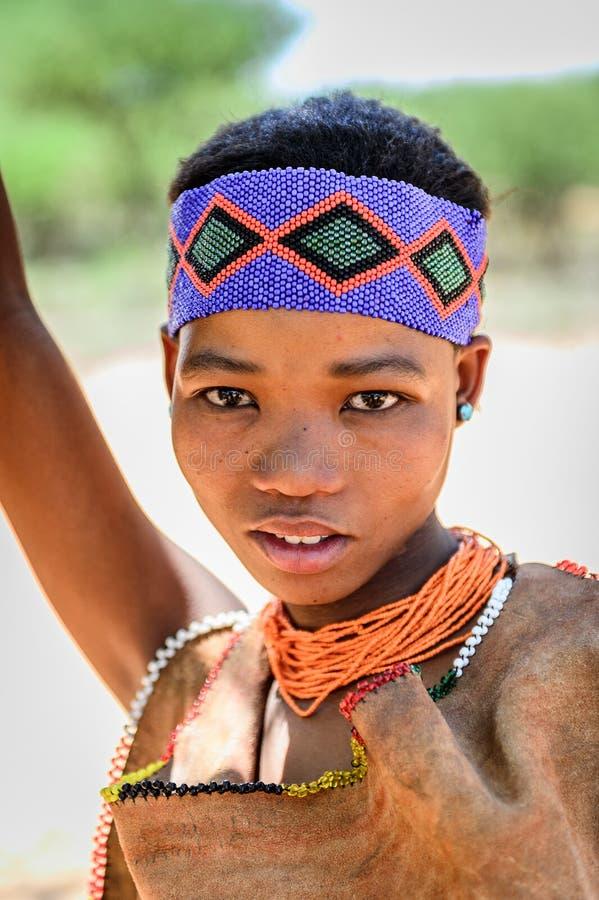 Bushman people in Namibia. EAST OF WINDHOEK, NAMIBIA - JAN 3, 2016: Unidentified bushman beautiful girl. Bushman people are members of various indigenous hunter royalty free stock images