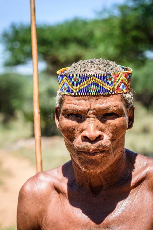 Bushman people in Namibia. EAST OF WINDHOEK, NAMIBIA - JAN 3, 2016: Unidentified bushman man portrait. Bushman people are members of various indigenous hunter royalty free stock image