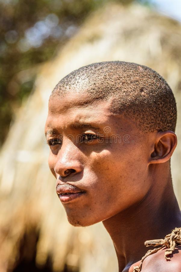 Bushman people in Namibia. EAST OF WINDHOEK, NAMIBIA - JAN 3, 2016: Unidentified bushman man portrait. Bushman people are members of various indigenous hunter royalty free stock images