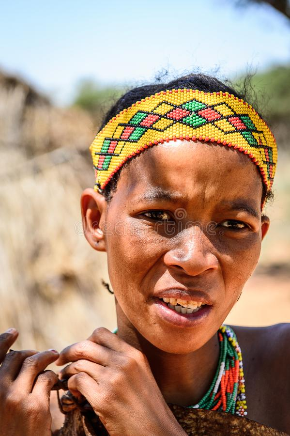 Bushman people in Namibia. EAST OF WINDHOEK, NAMIBIA - JAN 3, 2016: Unidentified bushman woman. Bushman people are members of various indigenous hunter-gatherer stock photography