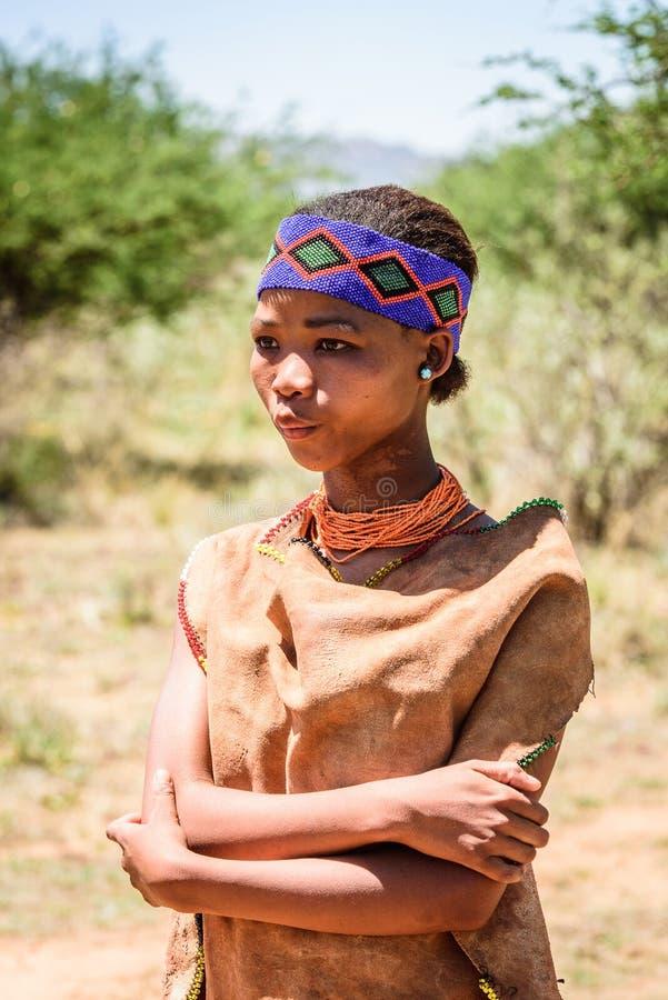 Bushman people in Namibia. EAST OF WINDHOEK, NAMIBIA - JAN 3, 2016: Unidentified bushman woman. Bushman people are members of various indigenous hunter-gatherer royalty free stock images