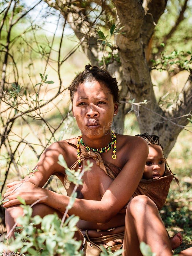 Bushman people in Namibia. EAST OF WINDHOEK, NAMIBIA - JAN 3, 2016: Unidentified bushman woman. Bushman people are members of various indigenous hunter-gatherer royalty free stock image