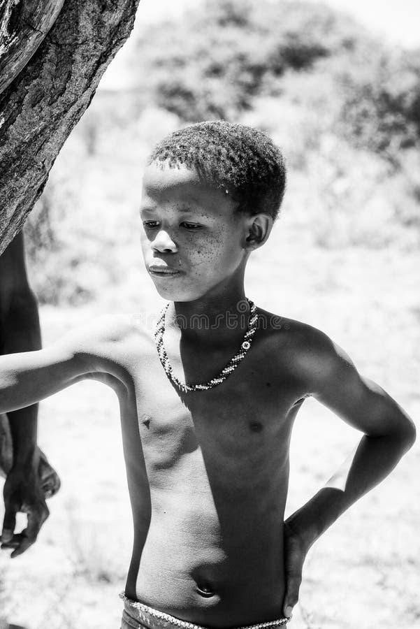 Bushman people in Namibia. EAST OF WINDHOEK, NAMIBIA - JAN 3, 2016: Unidentified bushmen boy. Bushmen people are members of various indigenous hunter-gatherer royalty free stock photography