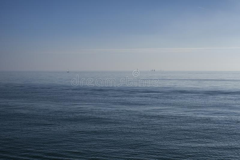 Eastbourne, East Sussex, England - a sea of blue. This image shows a view of the sea in Eastbourne, East Sussex, England, Europe. It was taken on a sunny day in royalty free stock image