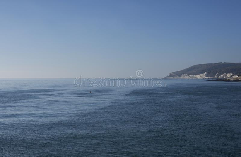 Eastbourne, East Sussex, England - the sea and the shore. This image shows a view of the sea in Eastbourne, East Sussex, south England, Europe. It was taken on stock photos
