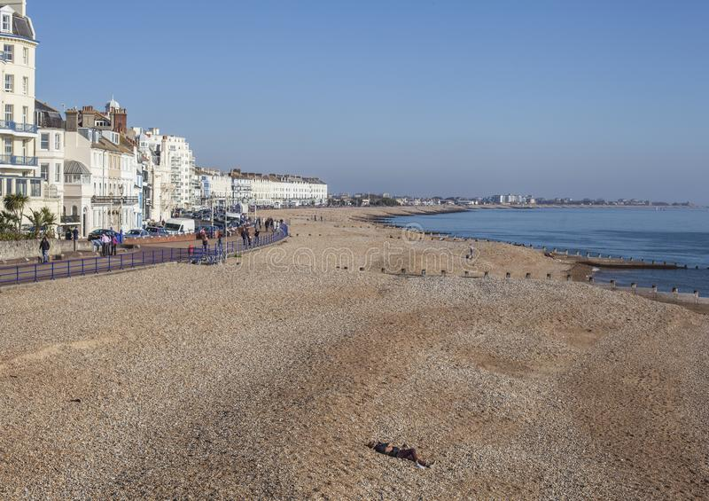 Eastbourne, East Sussex, England - the seafront, white hotels, blue skies and waters. stock photo