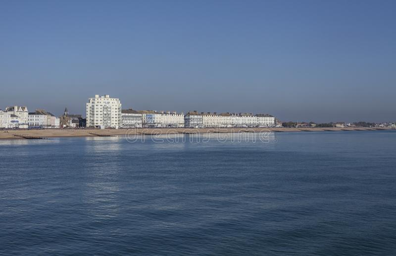 Eastbourne, East Sussex, England - white buildings at the seafront. This image shows a view of the some white buildings at the seafront in Eastbourne, East royalty free stock image