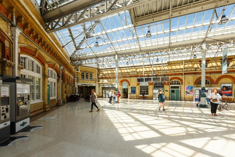 Interior of the Eastbourne train station, United Kingdom. Eastbourne, United Kingdom - AUGUST 1, 2017: interior of the Eastbourne train station in summer sunny stock image