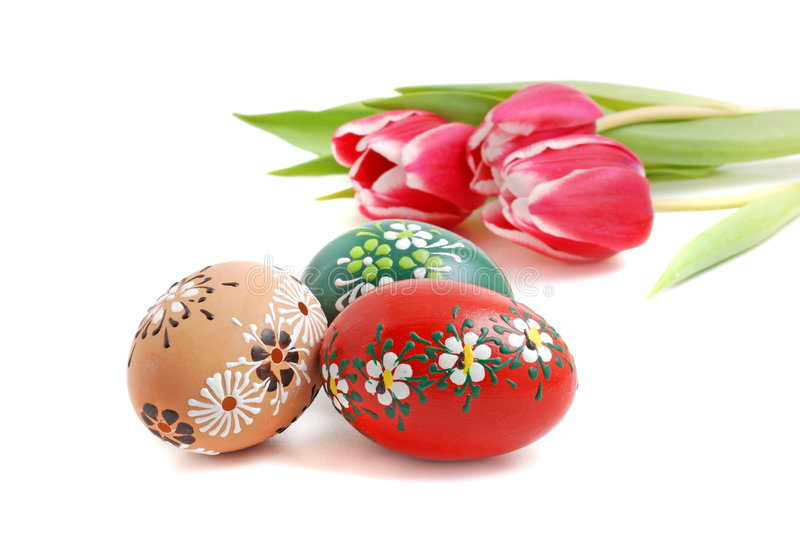 Easter. Eggs with tulips on white background stock photography
