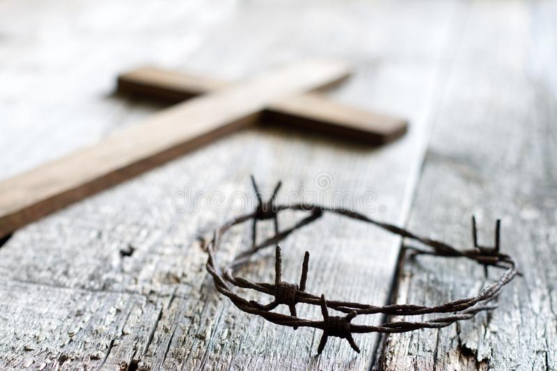 Easter abstract background with crown of thorns and cross on wooden planks royalty free stock photos