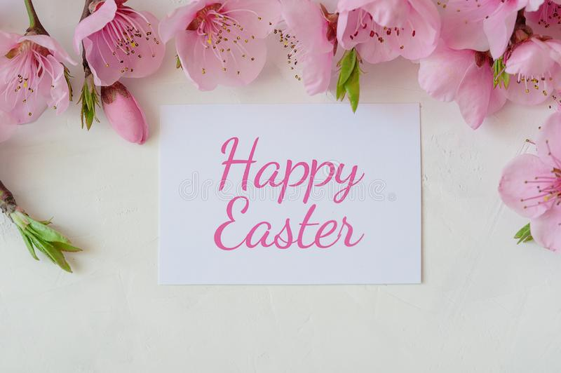Easter background with a bouquet of spring flowers and the inscription happy Easter . Festive Easter card stock image