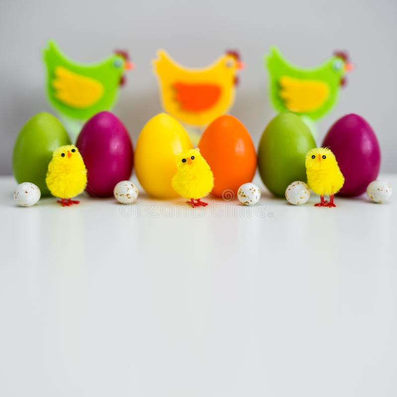 Easter background - close up of colorful painted Easter eggs and decorations with copy space stock images