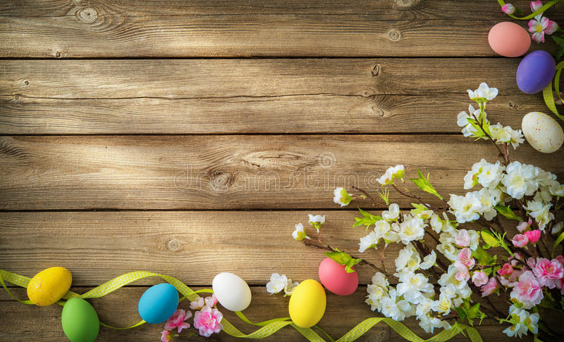 Easter background with colorful eggs and spring flowers royalty free stock images