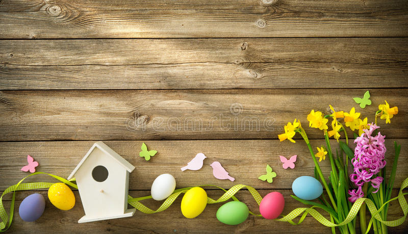 Easter background with colorful eggs and spring flowers stock image