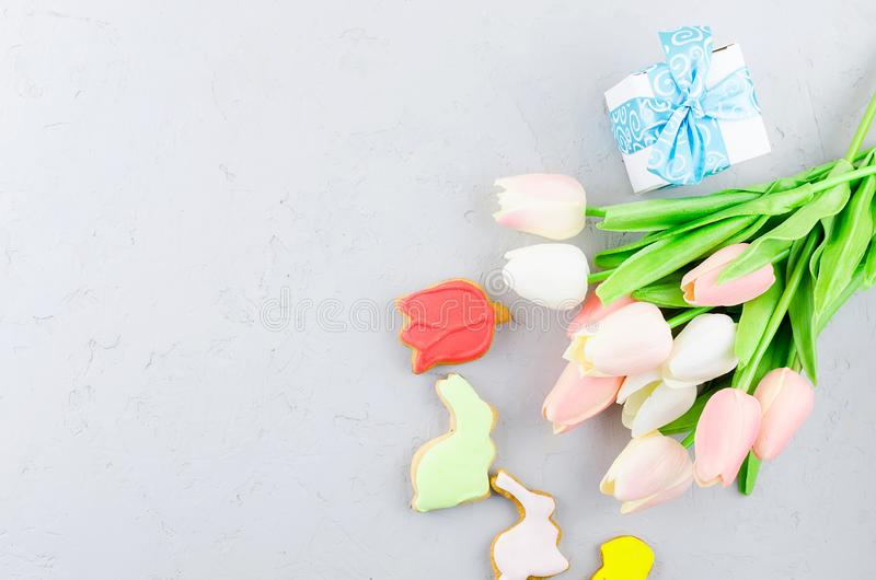 Easter  background with colorful gingerbread cookies eggs and flowers stock photos