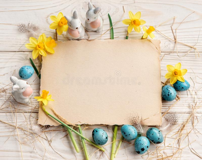 Easter background with Easter eggs and spring flowers. stock image