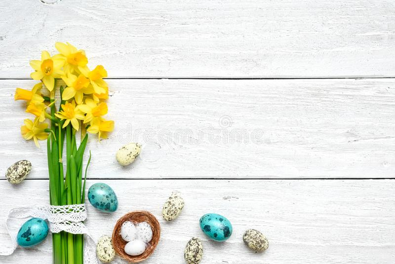 Easter Background with easter eggs and spring flowers on white wooden background stock images