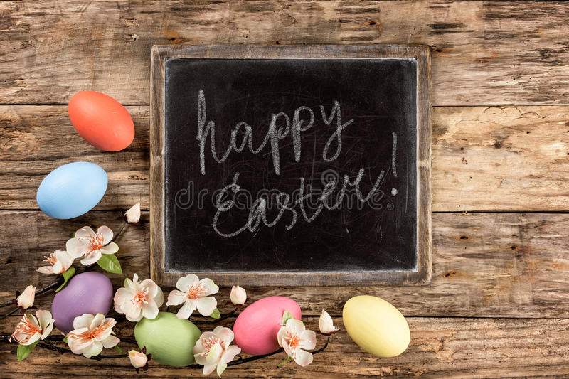 Easter background. Easter eggs and spring blossoms on the wooden background royalty free stock image