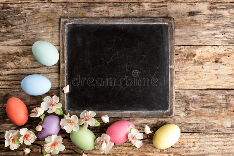 Easter background. Easter eggs and spring blossoms on the wooden background royalty free stock photo