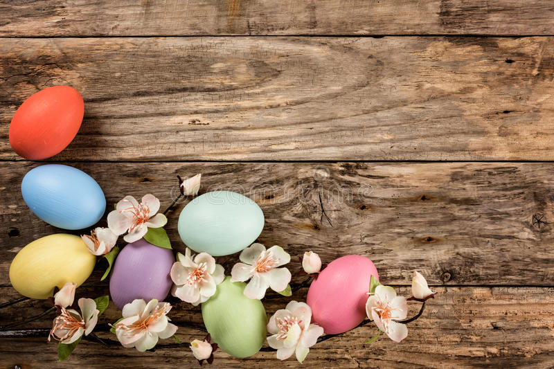 Easter background. Easter eggs and spring blossoms on the wooden background royalty free stock photos