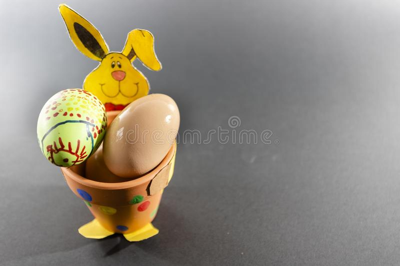 Easter background with Easter eggs and spring flowers. Top view with copy space royalty free stock image