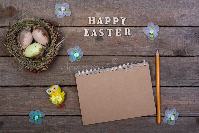 Easter background. The inscription of the wooden letters `Happy Easter`. royalty free stock images