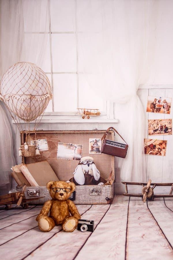 Travel background with white ballon, Tedy bear. Vintage syle stock photo