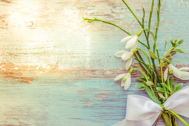Easter background with Easter eggs and spring flowers. Top view with copy space stock images