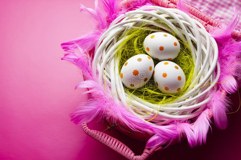 Easter background - three patterned eggs on pink background royalty free stock photography