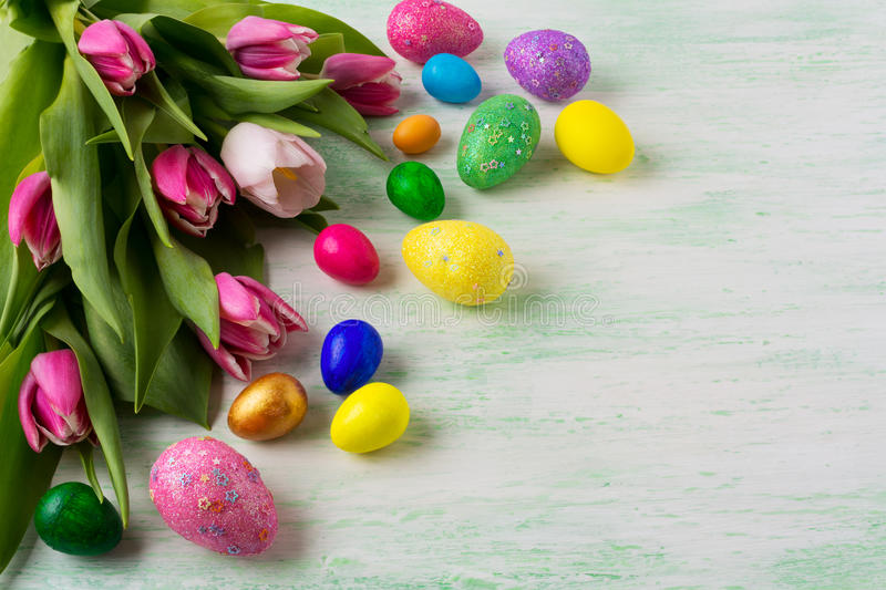 Easter background with vibrant painted eggs royalty free stock photography