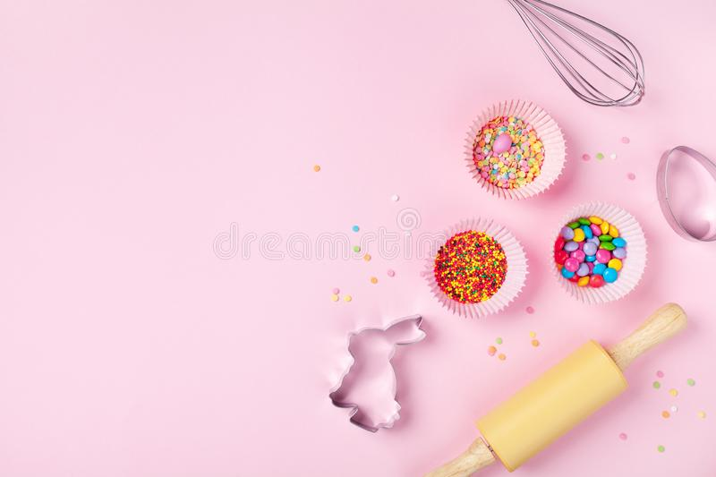 Easter baking background with kitchen tools for holiday sweet bakery top view. Flat lay. Style stock photography