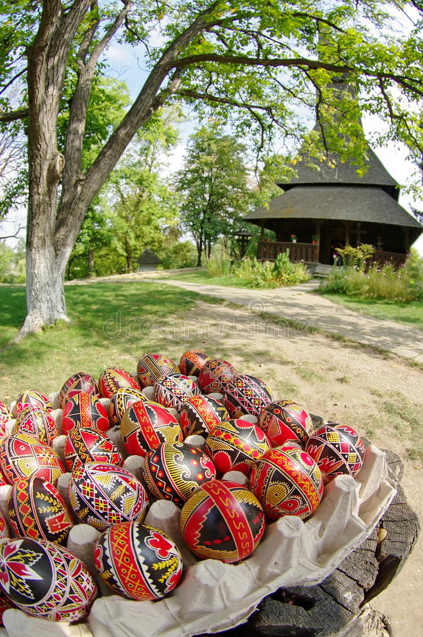 Easter. Hand painted eggs and traditional orthodox wooden church Barsana Monastery - landmark attraction in Maramures, Romania stock photos
