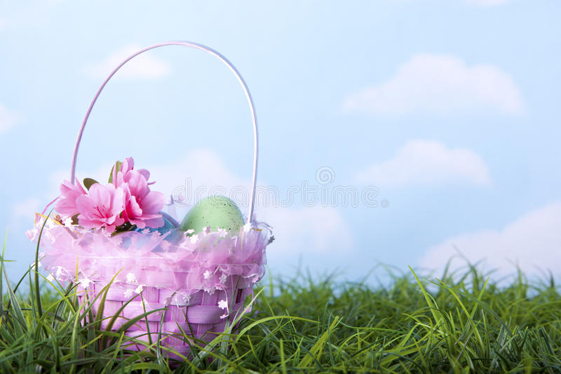 Easter basket and colorful eggs royalty free stock photo