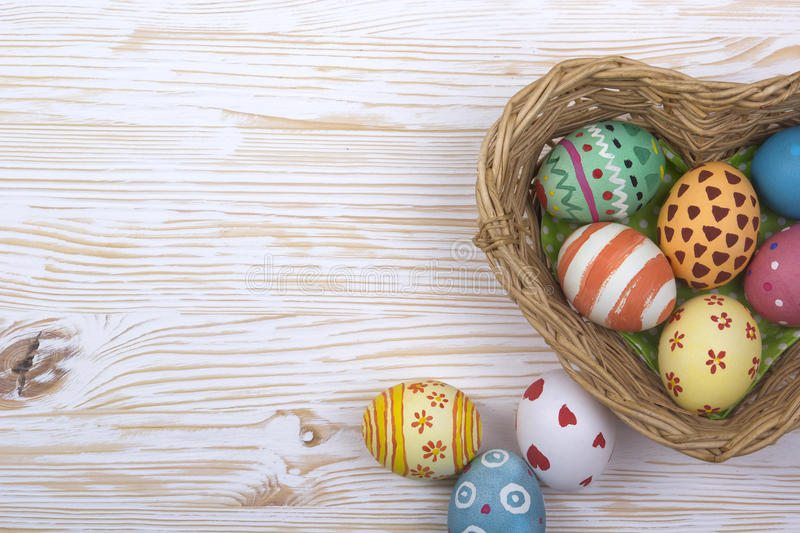 Easter basket with colorful eggs on a white background stock photo