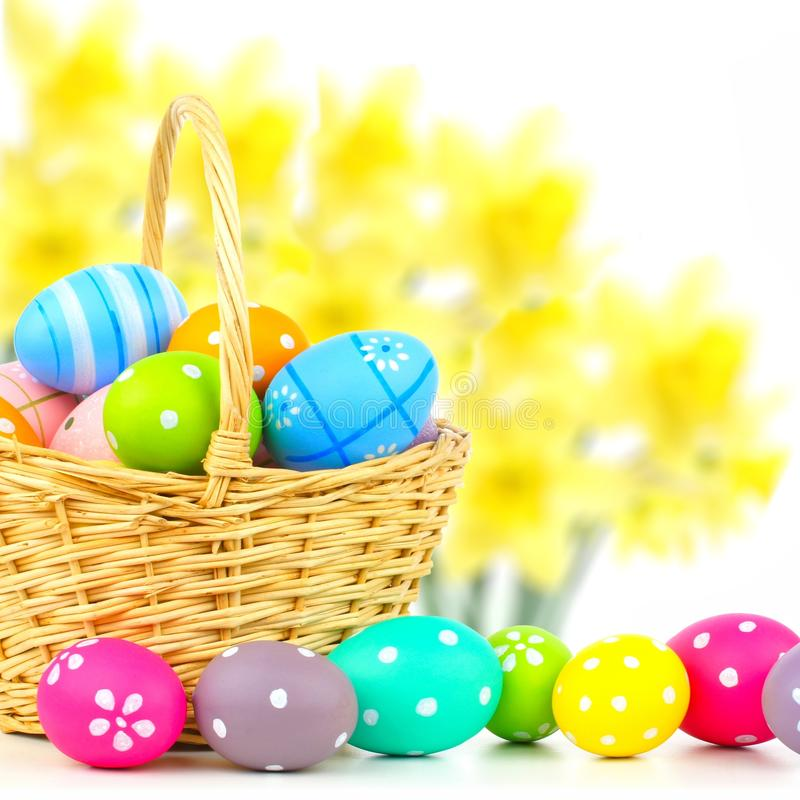 Easter basket with eggs and floral background