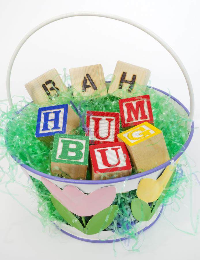 Grumpy Easter Basket. Easter basket filled with grouch`s BAH HUMBUG sentiment royalty free stock images